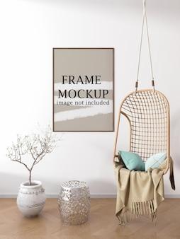 Mockup di cornice immagine verticale sul muro bianco