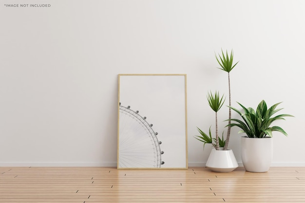 Modello di cornice per foto in legno verticale su parete bianca stanza vuota con piante su un pavimento di legno