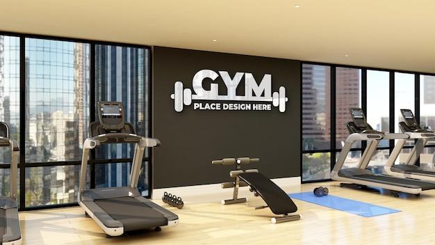 Mockup di logo palestra a parete nella moderna sala fitness