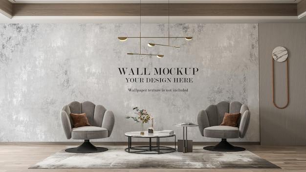 Mockup di parete dietro poltrone grigie contemporanee