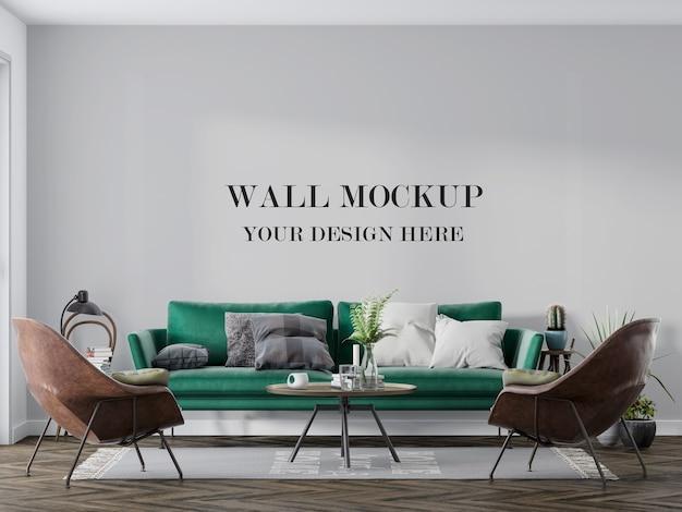 Mockup di parete dietro divano verde e sedie