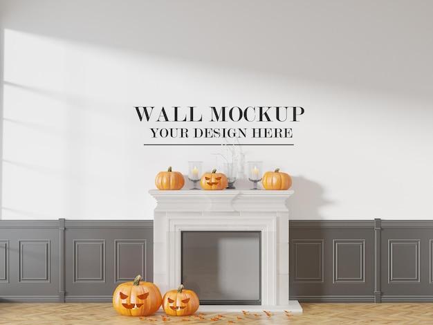 Mockup del muro dietro le zucche di halloween