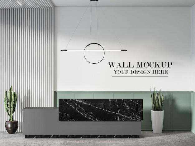 Mockup di parete dietro il bancone della reception in marmo