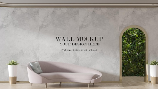 Mockup di parete dietro il divano rosa pallido