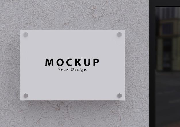 Mockup del logo della targa del segno da parete