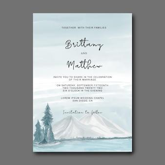 Carta di invito a nozze con illustrazione di paesaggi di montagna ad acquerello