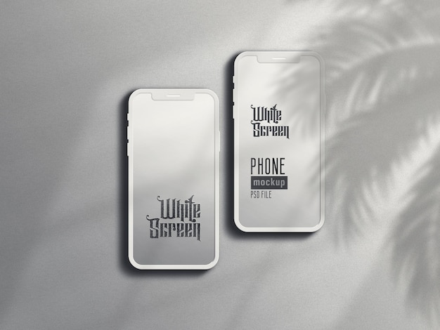 Mockup di smartphone in argilla bianca con ombra di foglie