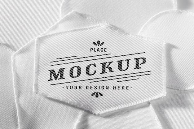 Mock-up in tessuto patch abbigliamento bianco