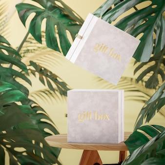 Modello bianco del contenitore di gioielli del regalo su fondo tropicale che levita per marcare a caldo il rendering 3d
