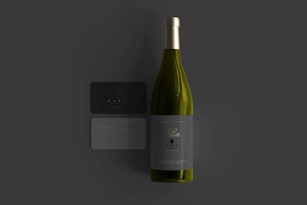 Bottiglia di vino bianco con biglietti da visita mockup