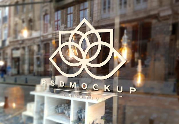 Mockup di segnaletica con logo sul vetro della finestra