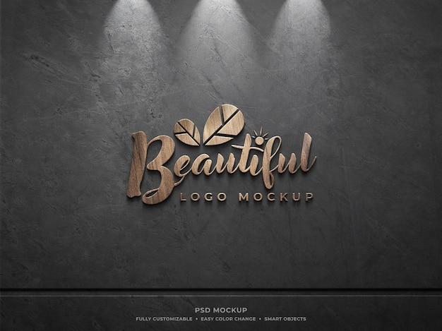 Mockup con logo in legno sul muro
