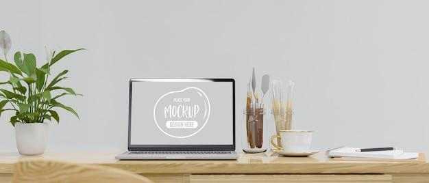 Lo spazio di lavoro con l'artigianato del laptop fornisce strumenti di pittura e vaso per piante sul rendering 3d del tavolo