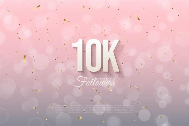 Sfondo 10k follower con numeri e sfondo rosa con effetto bokeh.