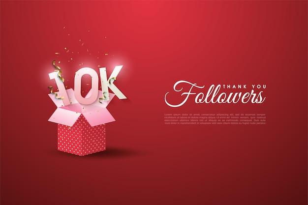 Sfondo di 10k follower con numeri sopra la confezione regalo.