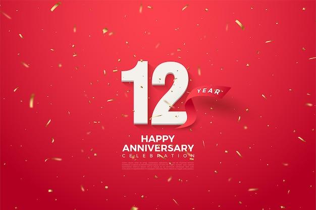 12 ° anniversario con numeri e un nastro rosso curvo dietro di esso.