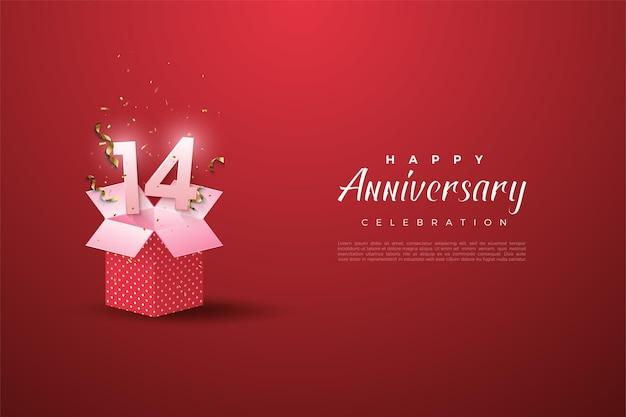 Il 14 ° anniversario con il numero sulla confezione regalo aperta.