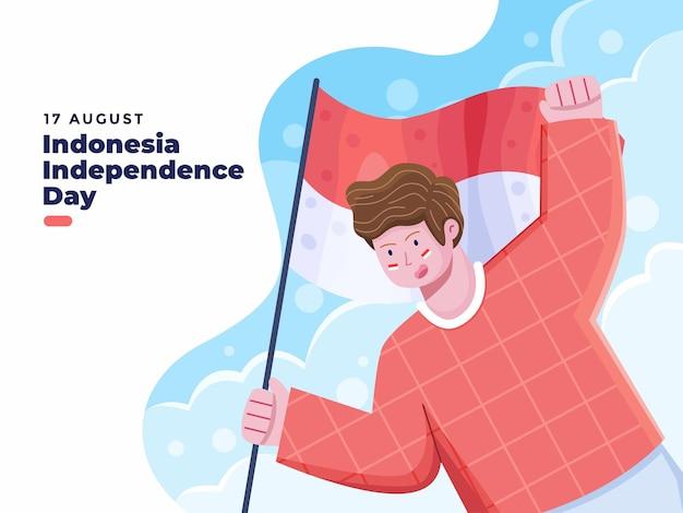 17 agosto illustrazione del giorno dell'indipendenza dell'indonesia con una persona che tiene la bandiera nazionale dell'indonesia