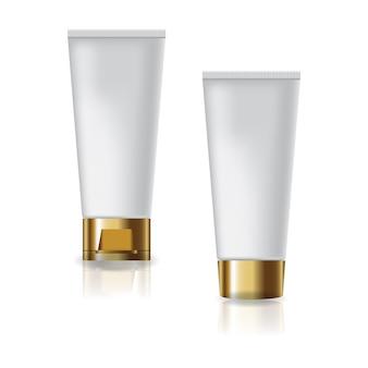 2 tubi cosmetici bianchi con tappo in oro e coperchio a vite per prodotti di bellezza o sani.