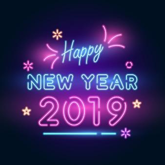 2019 capodanno. testo al neon con stelle luminose, fuochi d'artificio e luci.