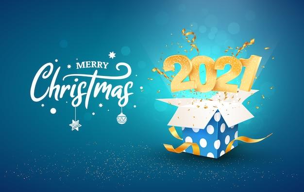 Illustrazione di felice anno nuovo 2021. buon natale. i numeri dorati volano fuori dalla confezione regalo blu