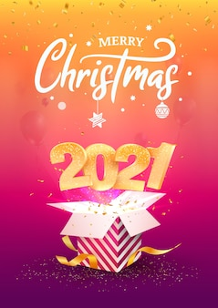 Felice anno nuovo 2021. buon natale. i numeri dorati volano fuori dalla confezione regalo blu