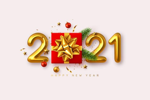 Felice anno nuovo 2021. confezione regalo realistica con elementi decorativi e numeri metallici 3d su sfondo bianco.