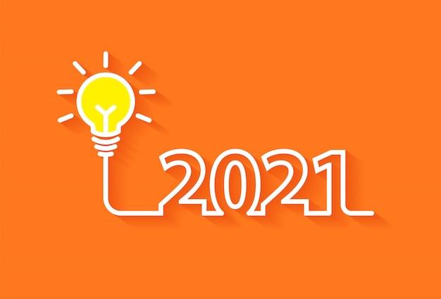 Concetto di idee di ispirazione della lampadina di creatività del nuovo anno 2021