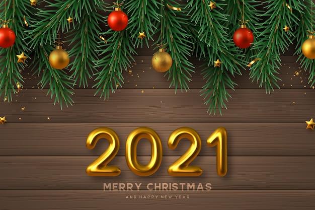 Segno di nuovo anno 2021. sfondo di natale allegro con numeri 3d dorati realistici, palline d'oro e rosse, rami di pino e stelle. fondo in legno.