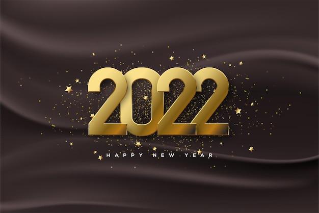 2022 celebrazione del felice anno nuovo con numeri d'oro e spruzzi di colore oro