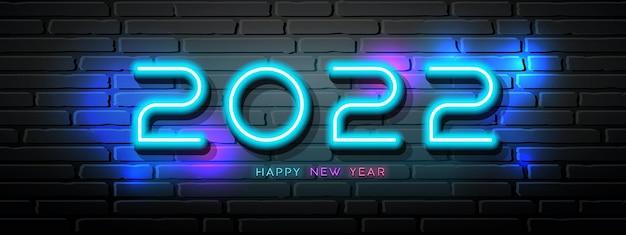 2022 happy new year neon light numero design su blocco parete sfondo nero illustrazione vettoriale
