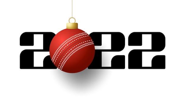 2022 felice anno nuovo. biglietto di auguri sportivo con palla da cricket dorata sullo sfondo di lusso. illustrazione vettoriale.