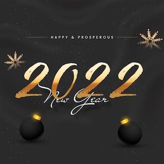 Testo di felice anno nuovo 2022 con fiocchi di neve dorati e palline 3d su sfondo nero.