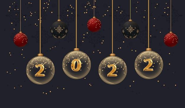 Banner di capodanno 2022 su sfondo scuro volantino di natale con palline di vetro con numeri e glitter