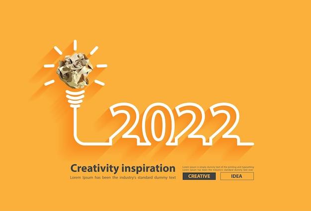 Ispirazione alla creatività del nuovo anno 2022 con design del concetto di idee di lampadine a sfera di carta stropicciata, illustrazione vettoriale