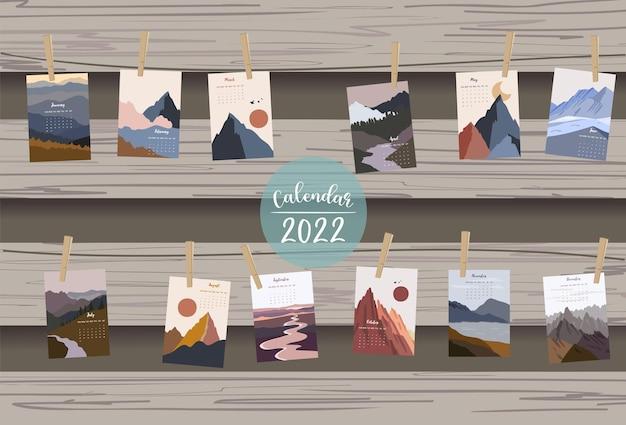 La settimana del calendario da tavolo 2022 inizia di domenica con la montagna e il sole che utilizzano per il formato a4 a5 verticale e stampabile digitale