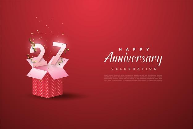 27 ° anniversario con un'illustrazione del numero su una confezione regalo aperta.