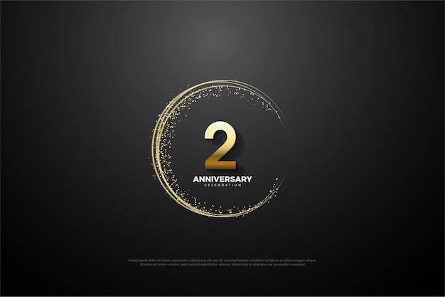 Sfondo del 2 ° anniversario con numeri e sabbia dorata che formano un cerchio imperfetto.