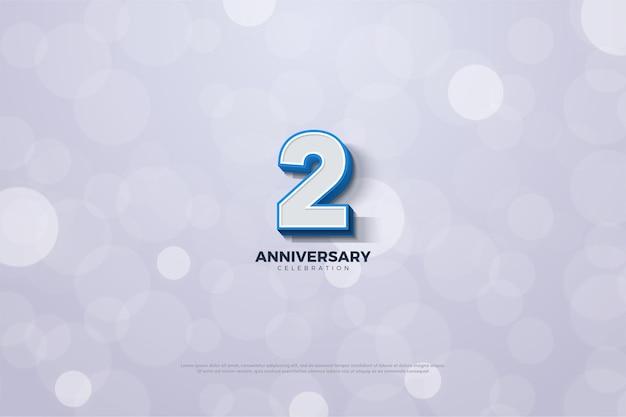 2 ° anniversario con numero 3d e bordo blu in grassetto.