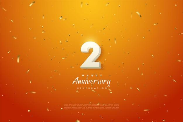 2 ° anniversario con numeri in grassetto bianco su sfondo arancione.