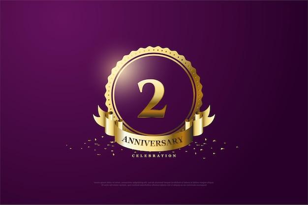 2 ° anniversario con numeri d'oro in un cerchio d'oro e un nastro.