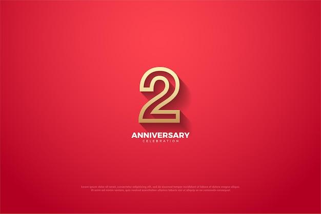 2 ° anniversario con illustrazione del numero delineato d'oro su sfondo rosso.