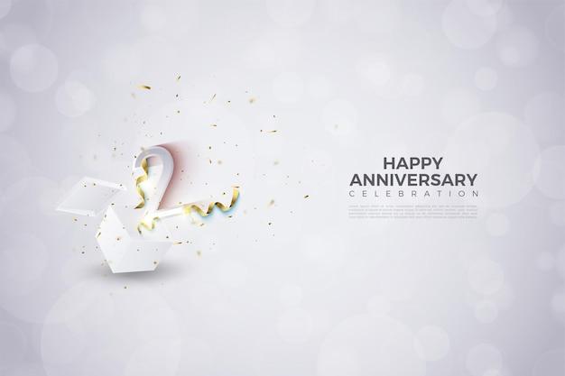 2 ° anniversario con illustrazione di numeri che esplodono dall'interno della scatola dell'ammortizzatore.