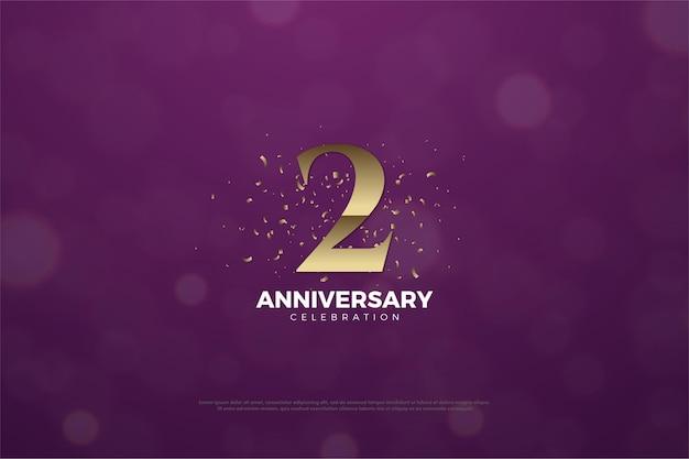 2 ° anniversario con numero e macchie d'oro.