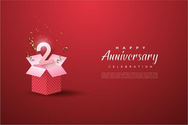 2 ° anniversario con illustrazione del numero sulla confezione regalo.