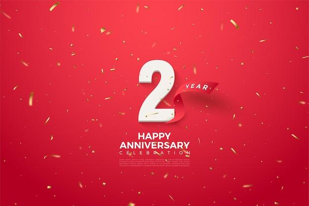 2 ° anniversario con l'illustrazione del nastro rosso curvo dietro i numeri.