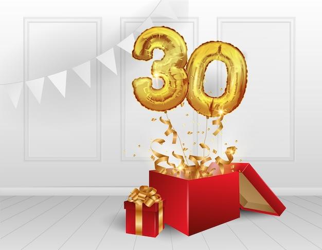 30 anni di palloncini d'oro. la celebrazione dell'anniversario. palloncini con coriandoli scintillanti volano fuori dalla scatola, numero 30.