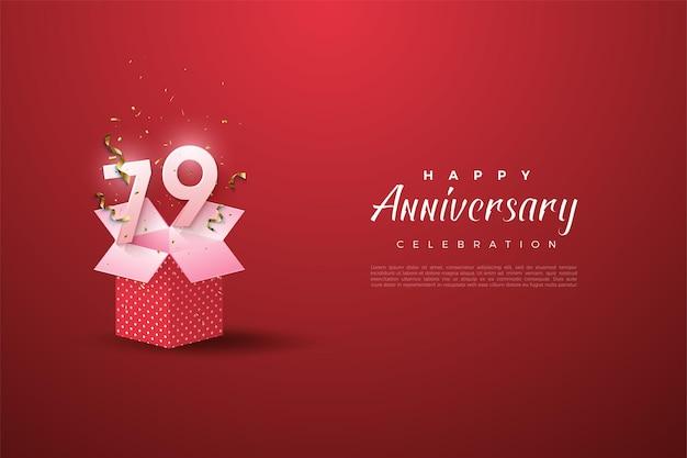 79° anniversario con numeri su una scatola aperta