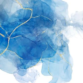 Fondo liquido blu astratto dell'acquerello con cracker dorati.