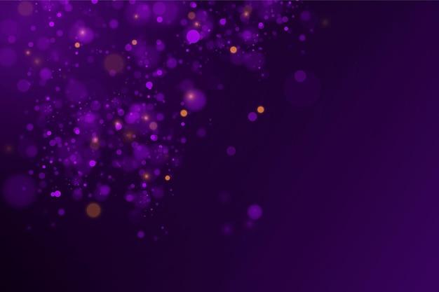 Effetto bokeh astratto polvere magica scintillante e particelle blu viola